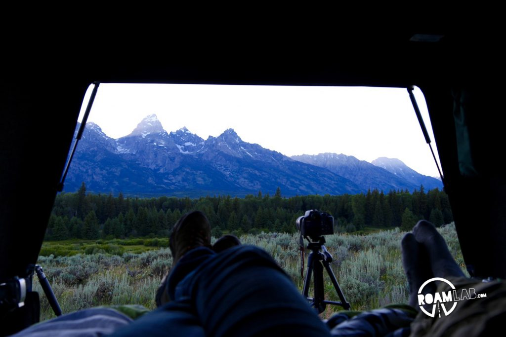 Camping out in the truck bed, as the sun sets over the Tetons. We had two tripods set up for quick shots in between sips of wine.