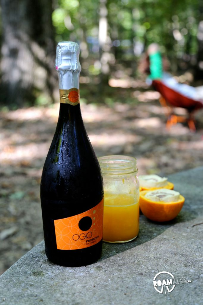 Ready for mimosas: sparkling wine and freshly squeezed orange juice - the remnants of Big Boys & Girls Boozy Campground Orange Sticky Rolls