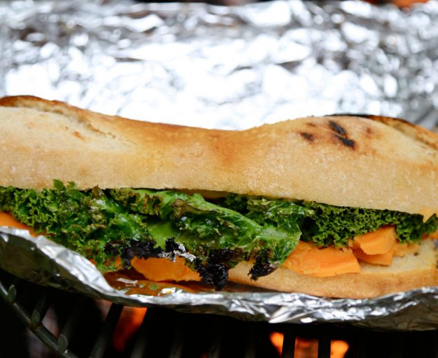A vegetarian-friendly sandwich for the campfire: Grilled Sweet Potato, Kale, & Goat Cheese Baguette