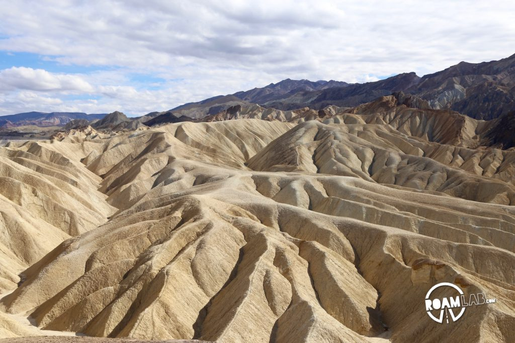 The land around Zabriskie Point drapes like fabric settling over a hidden structure.
