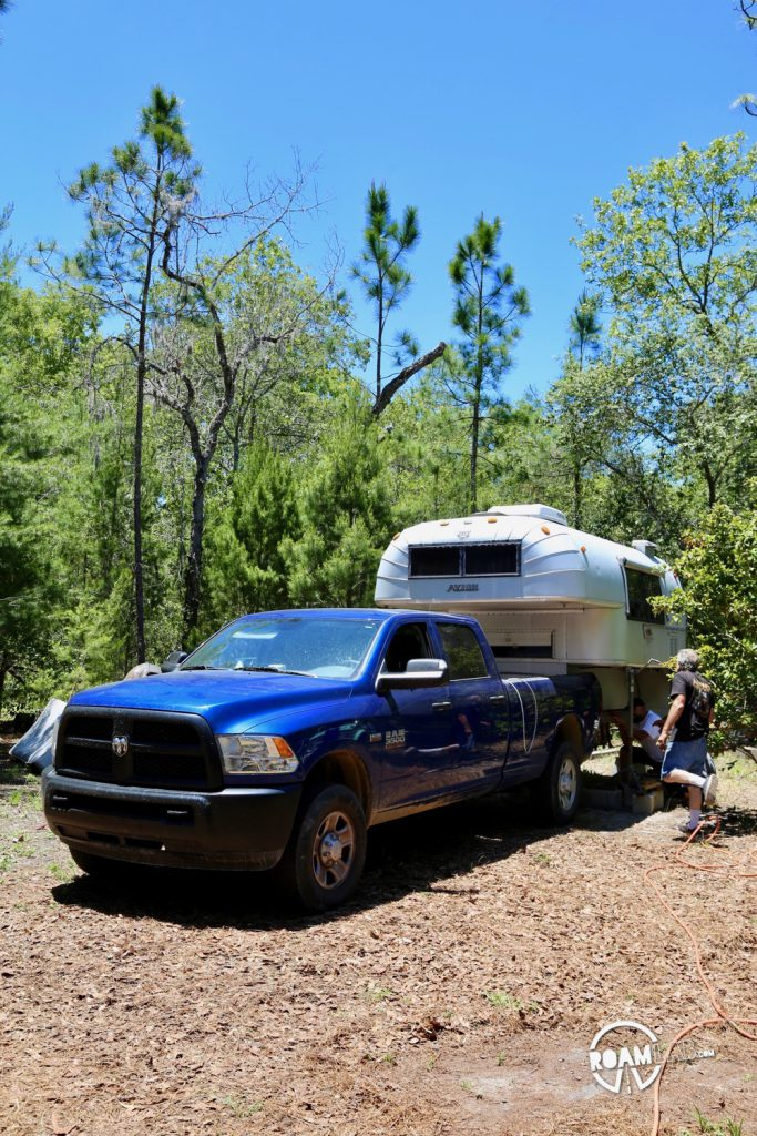1970 Avion C11 truck camper on jacks in the previous owners back yard with out 2015 Ram 3500.