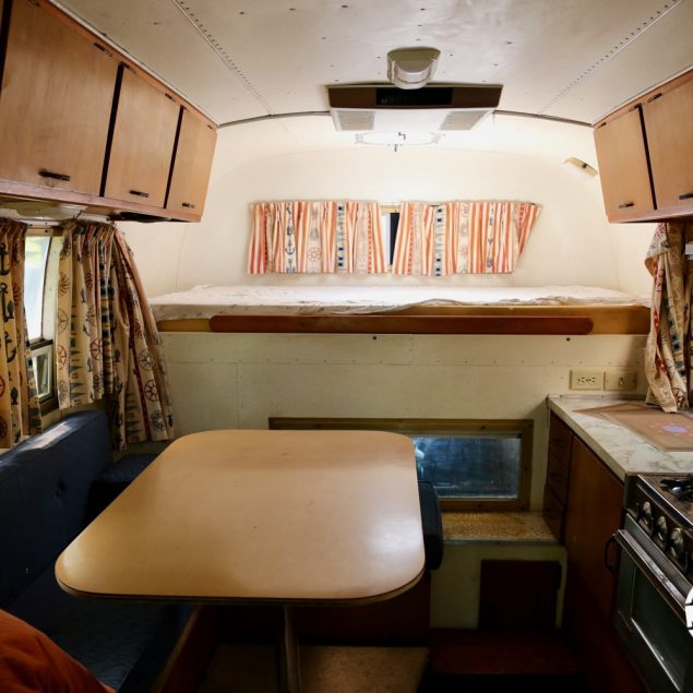 Interior view facing the bed of a 1970 Avion C11 truck camper.