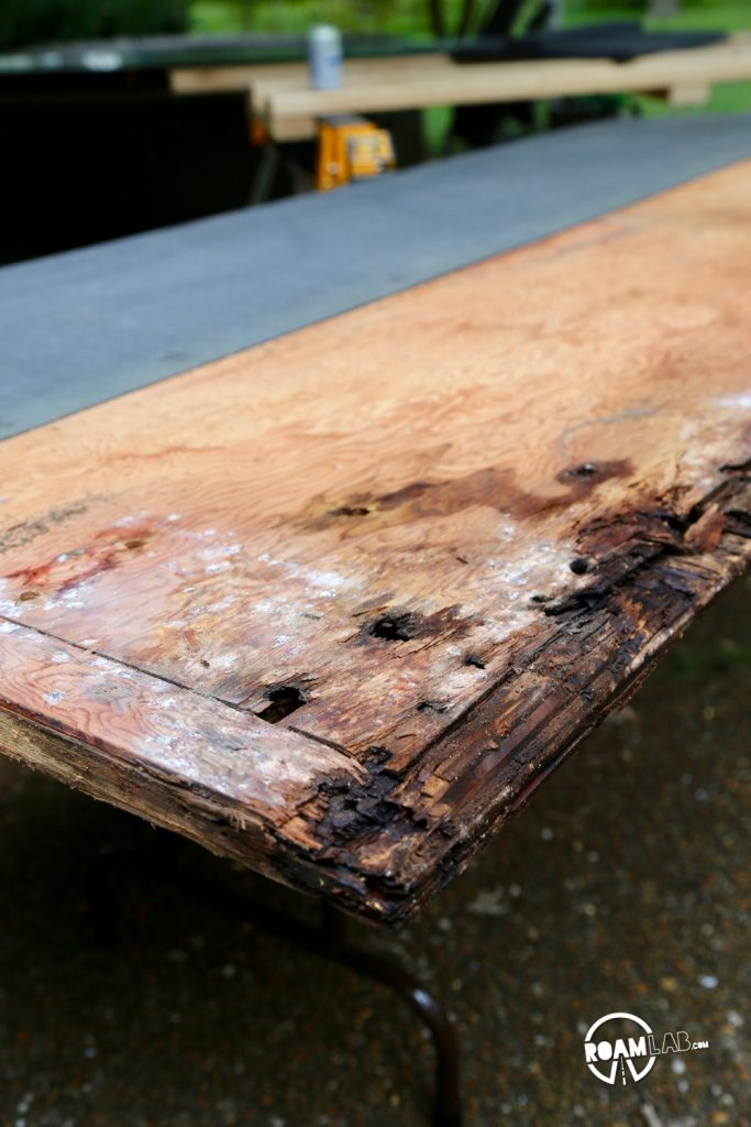 The two large, noticeable holes on this rotten board are where the jack point was mounted.  A little lower in the shot are two other holes in the middle of all the rotten wood...yeah, that was the tie down point.  I'm just grateful it didn't give before we had a chance to replace it.
