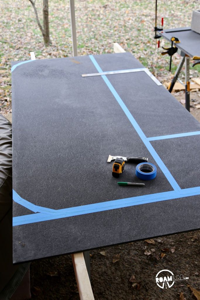 Outlining the entry section of the truck camper's floor where the rounded corners add support and structure to the rounded aluminum walls.