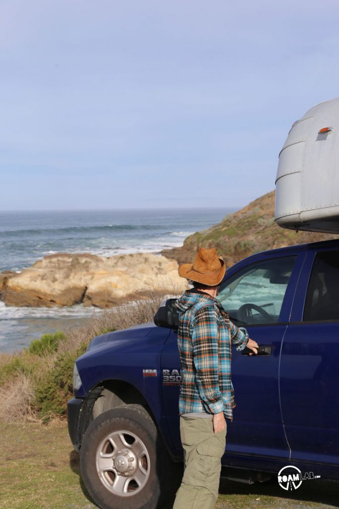 Exploring the Montaña de Oro State Park shoreline with the Avion Ultra C11 truck camper.