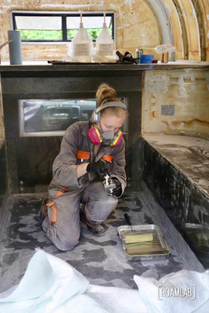 Mixing epoxy to re-enforcing the truck camper floor.