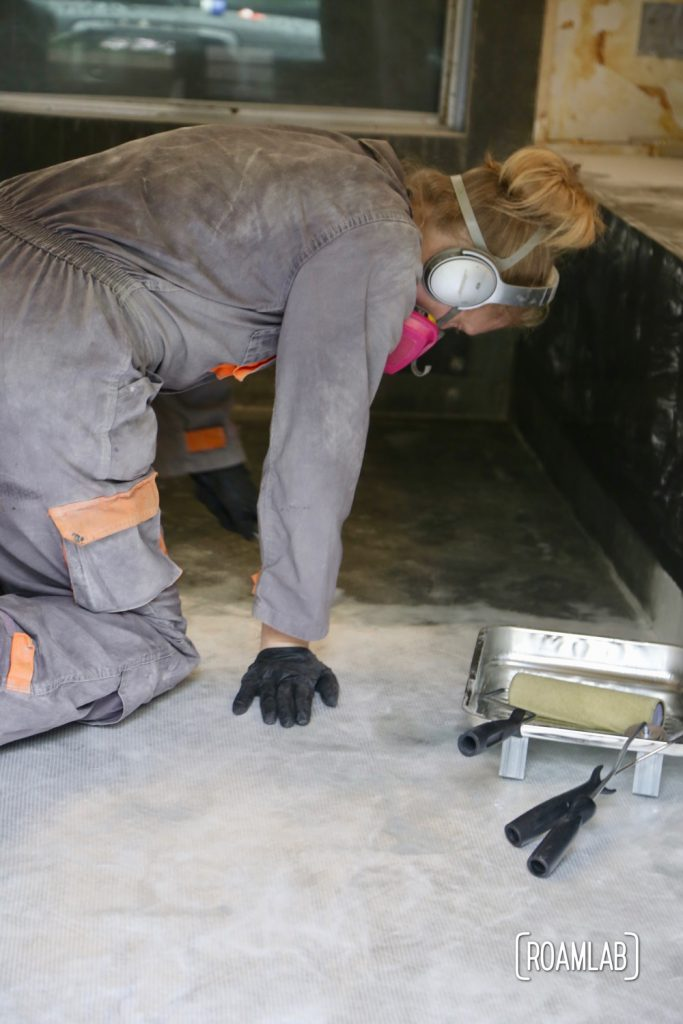 Wetting down fiberglass cloth to re-enforcing the truck camper floor.