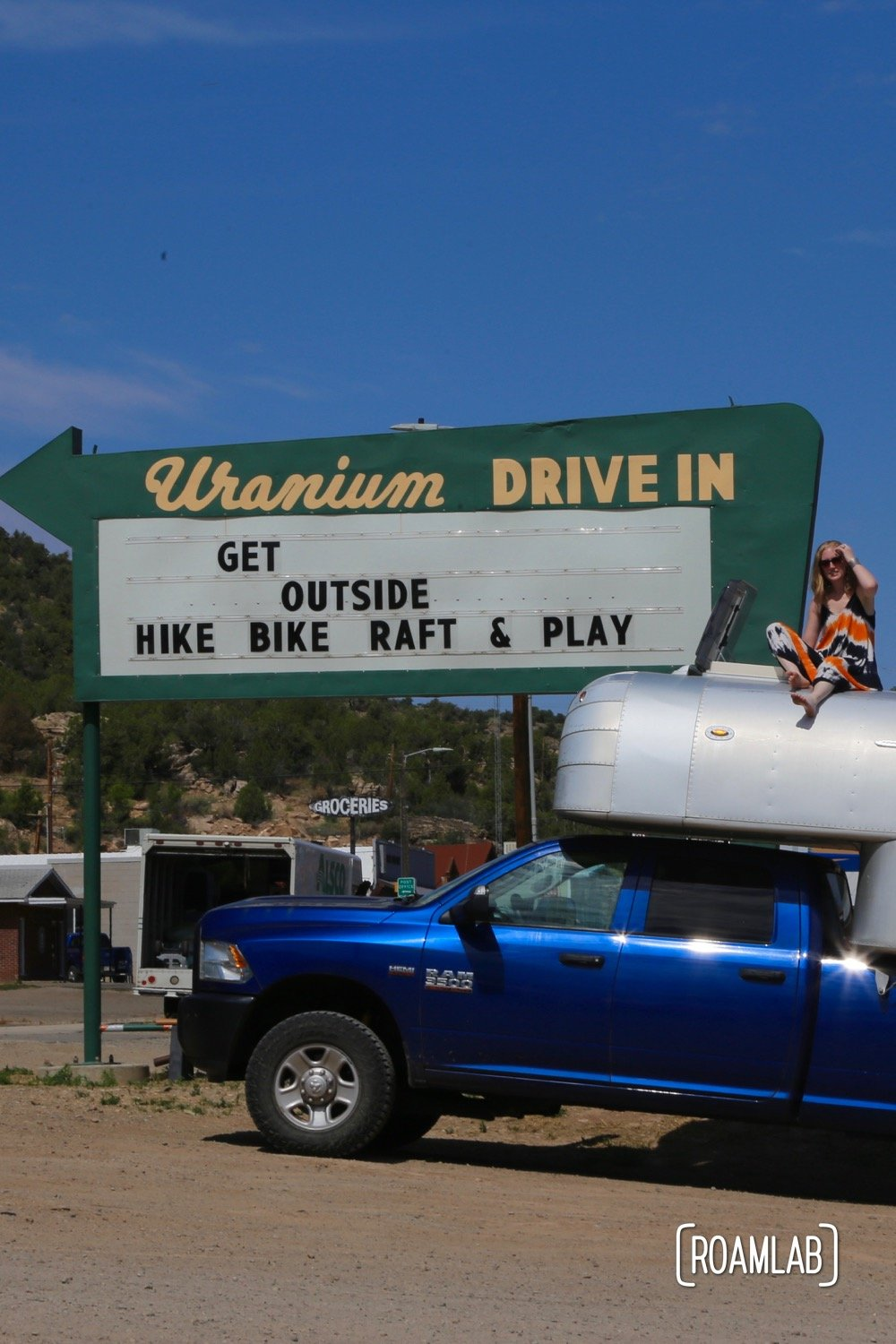 Hanging out by a reclaimed drive-through sign in Nucla, Colorado.