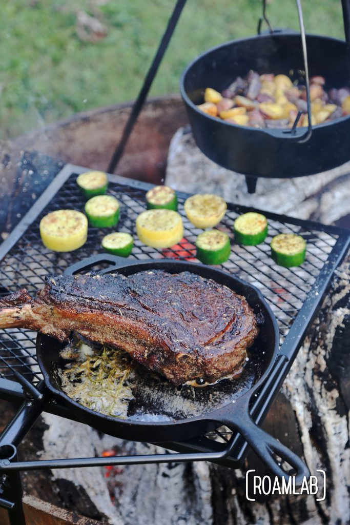 Grilling tomahawk steak over and open campfire is a challenging and delicious undertaking.