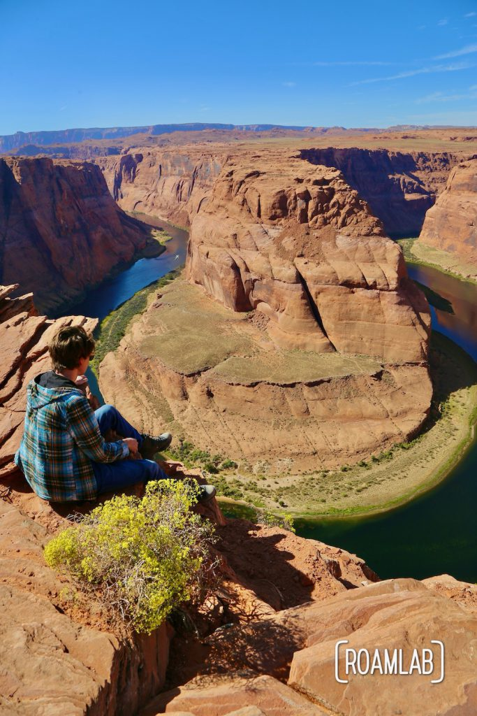 Sitting on the edge of Horseshoe Bend