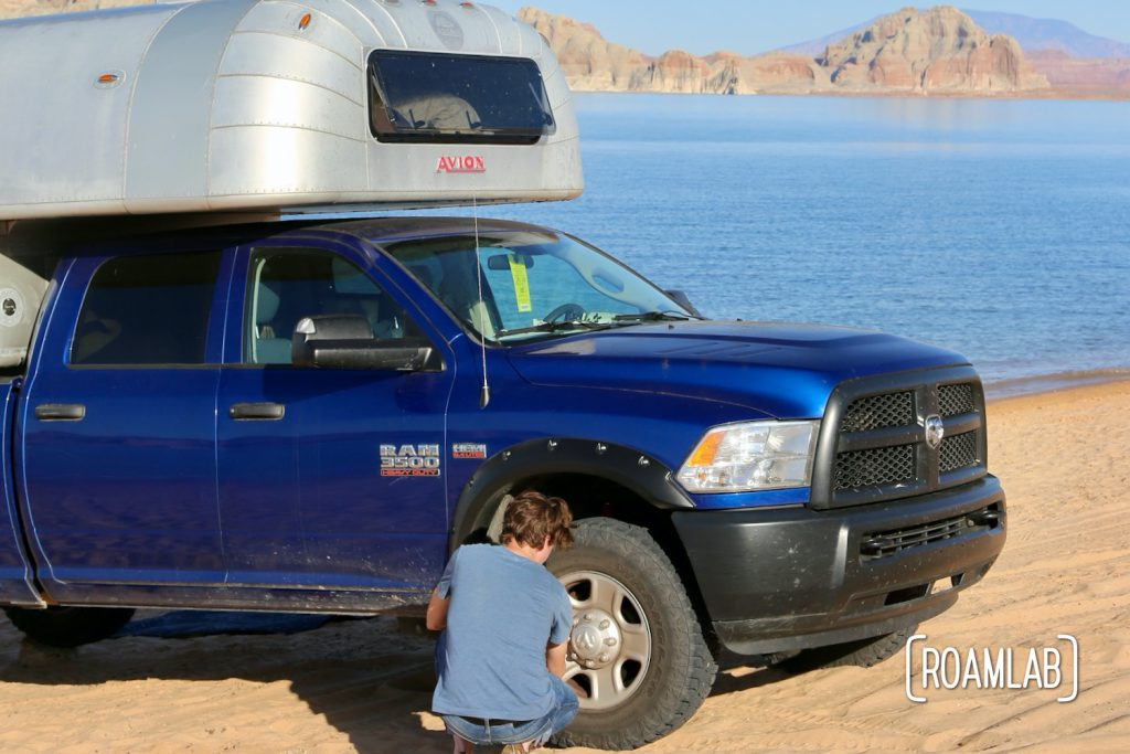Airing down the tires of a truck camper when driving on the sand.