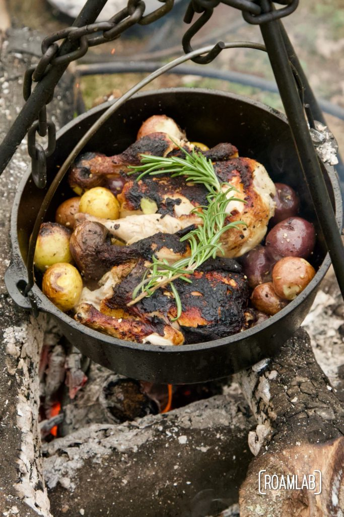 Roast this rosemary cornish game hen and potatoes recipe in a dutch oven over an open camp fire for a classy campground dinner or in your oven at home.