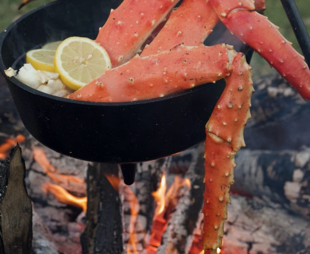 King Crab boiling in a cast iron dutch oven over a campfire