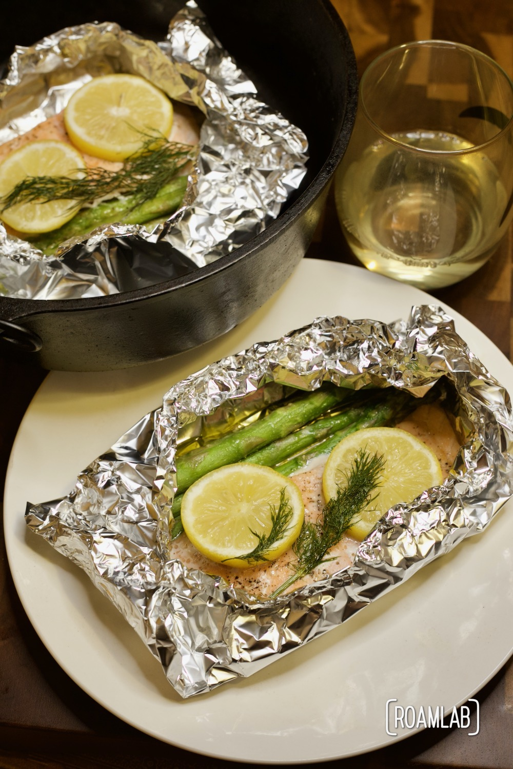 Enjoy this simple seafood course with our tin foil salmon campfire cooking dinner recipe. Add veggies with the fillet to make a full meal in one packet.