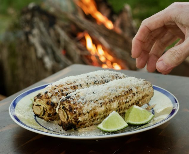 Enjoy this Mexican street corn campground noshing delight: tin foil elote campfire cooking appetizer recipe with cotija cheese, chili powder, and lime.