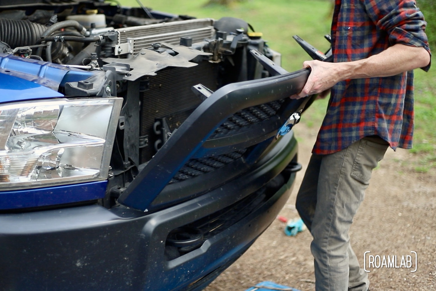 We step into the roll of DIY automotive mechanics as we remove the grille on our 2015 Ram 3500 Tradesman truck to expose the front bumper.