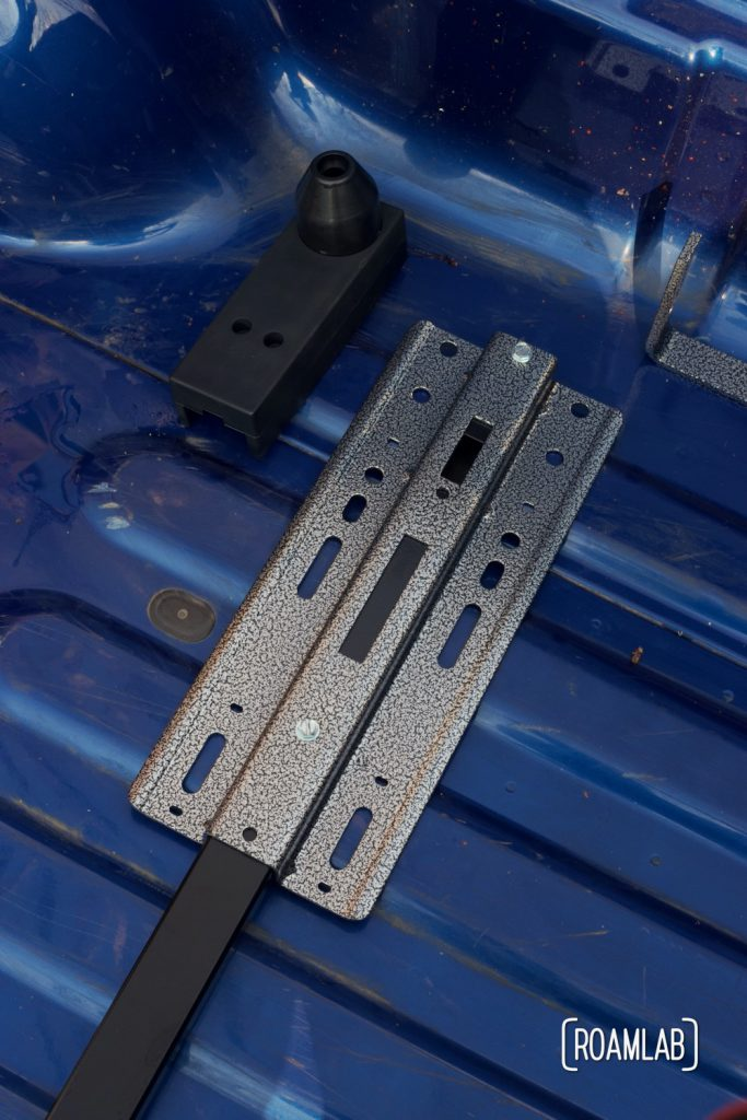 Screws in place, securing guide plate and stabilizer bar.