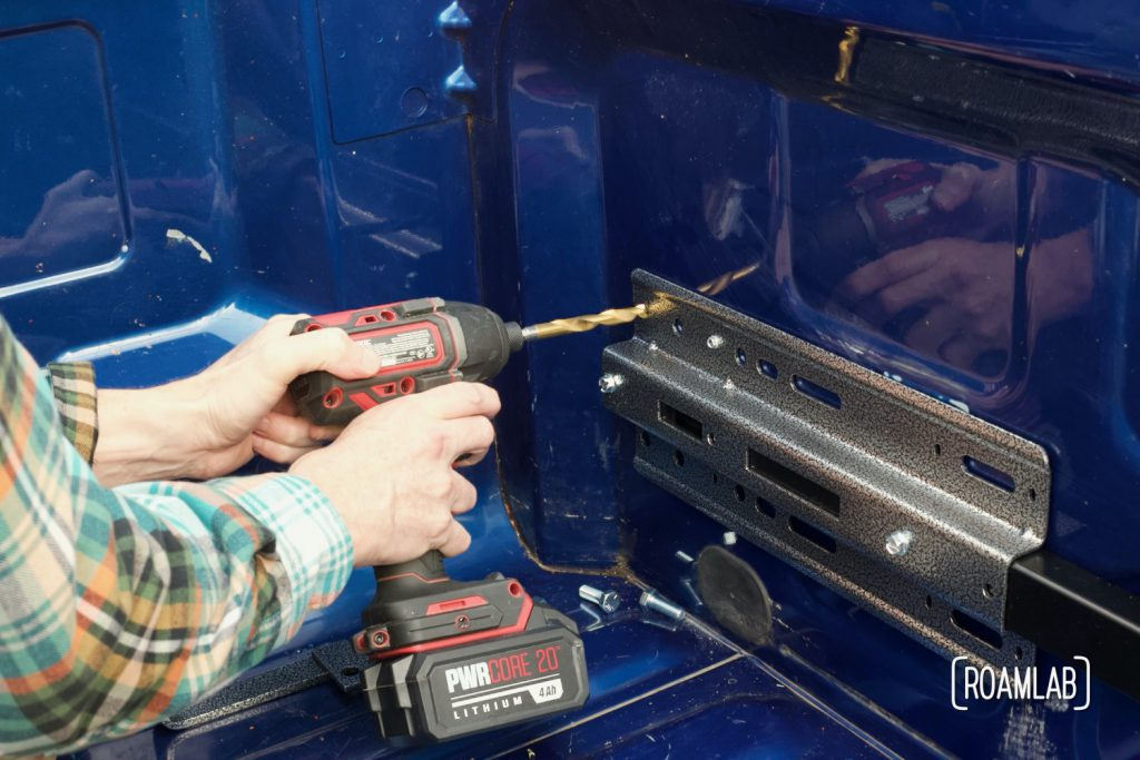 """Drilling 7/16"""" holes to bolt the front anchor plate to the guide plate."""
