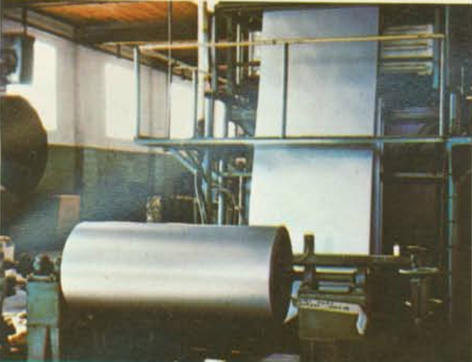 Rolls of sheet aluminum in a factory being anodized.