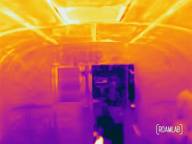 Rear thermal view of the Avion featuring the back door (open), a small back window, and the ceiling fan. (86.4-116.6°F)