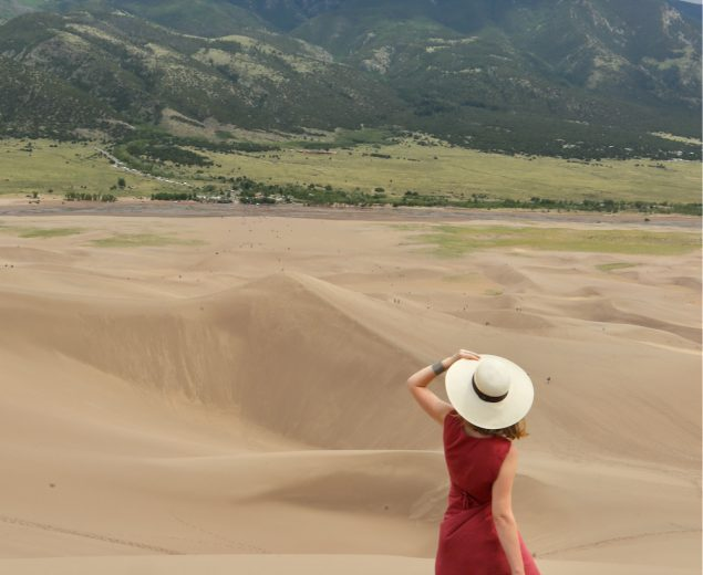 Woman looking out to the mountains in Great Sand Dunes National Park