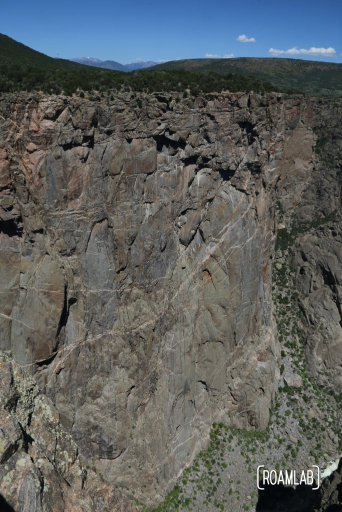Looking down a sheer cliff in the Black Canyon of the Gunnison National Park in Colorado