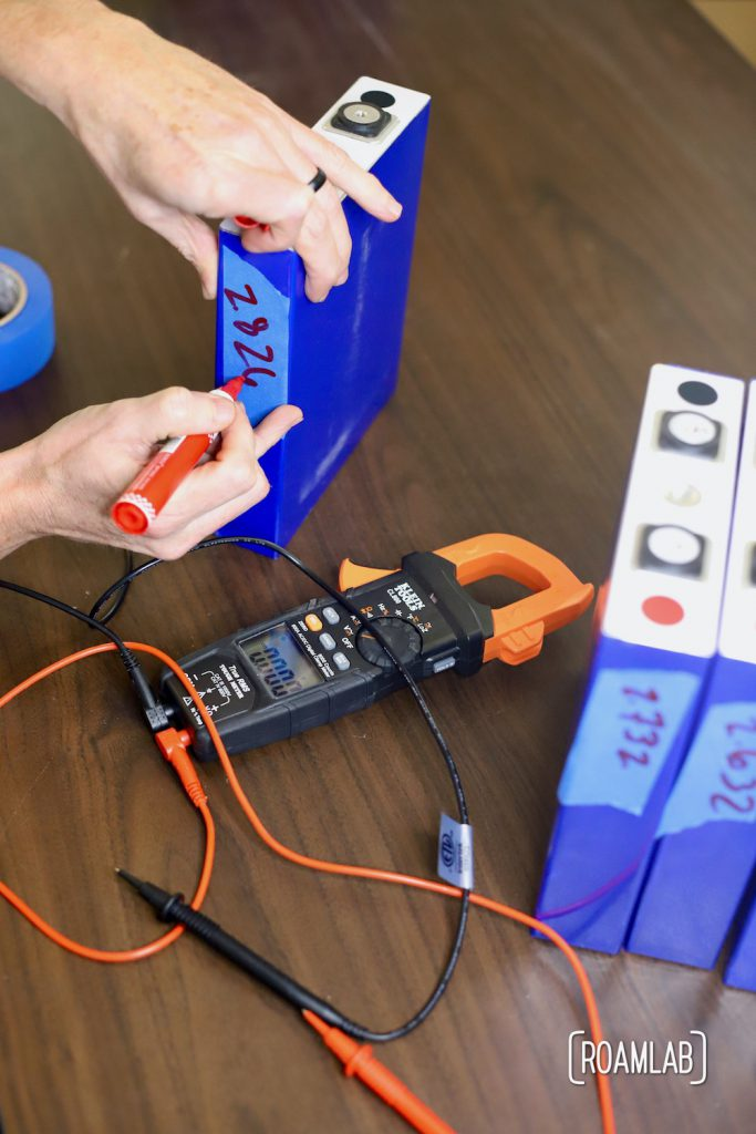 Marking voltage on battery cell.