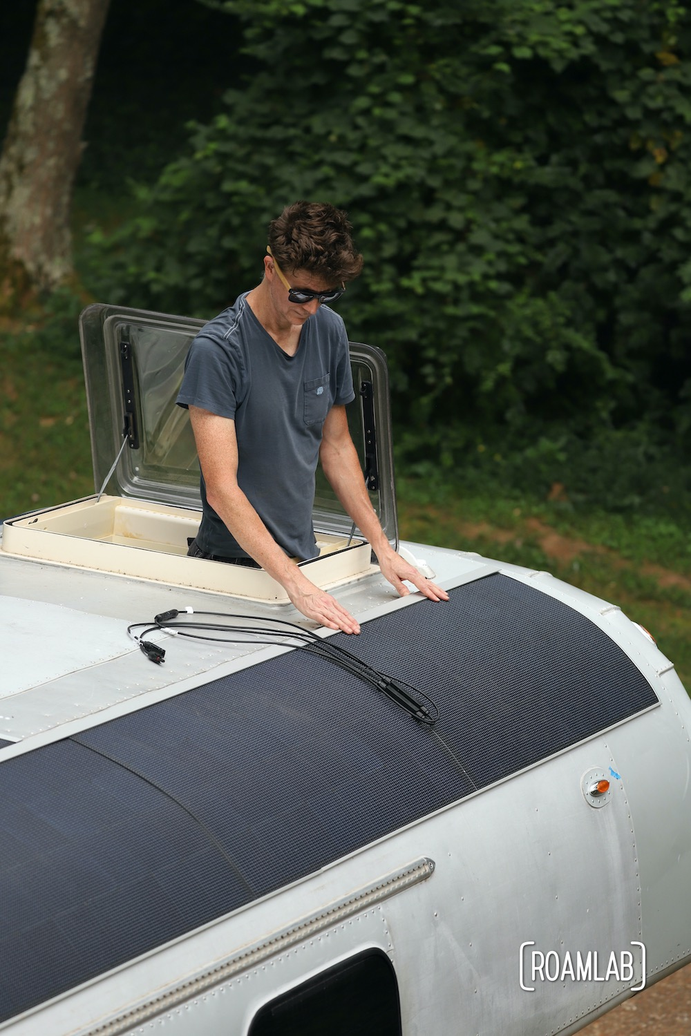 Test fitting solar panels on a 1970 Avion C11 truck camper roof.
