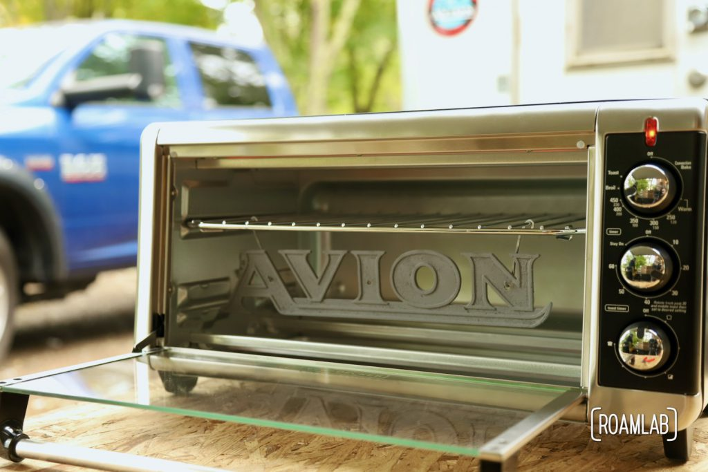 Avion emblem ready to cure the chrome powder coat in a toaster oven.