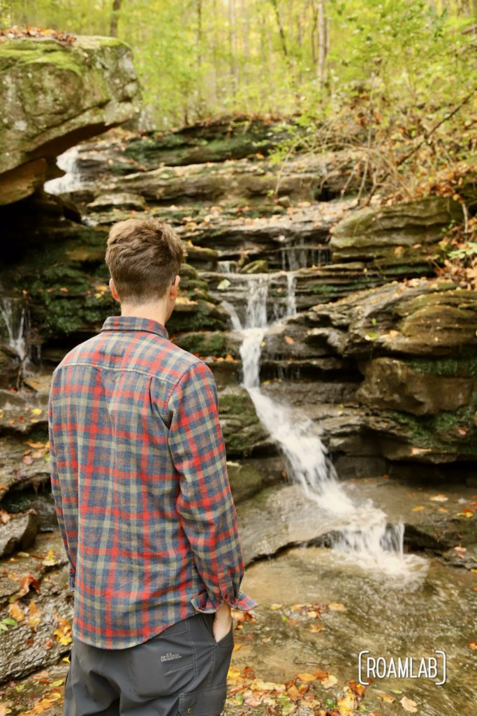 Man looking at waterfall in the Prentice Cooper State Park.