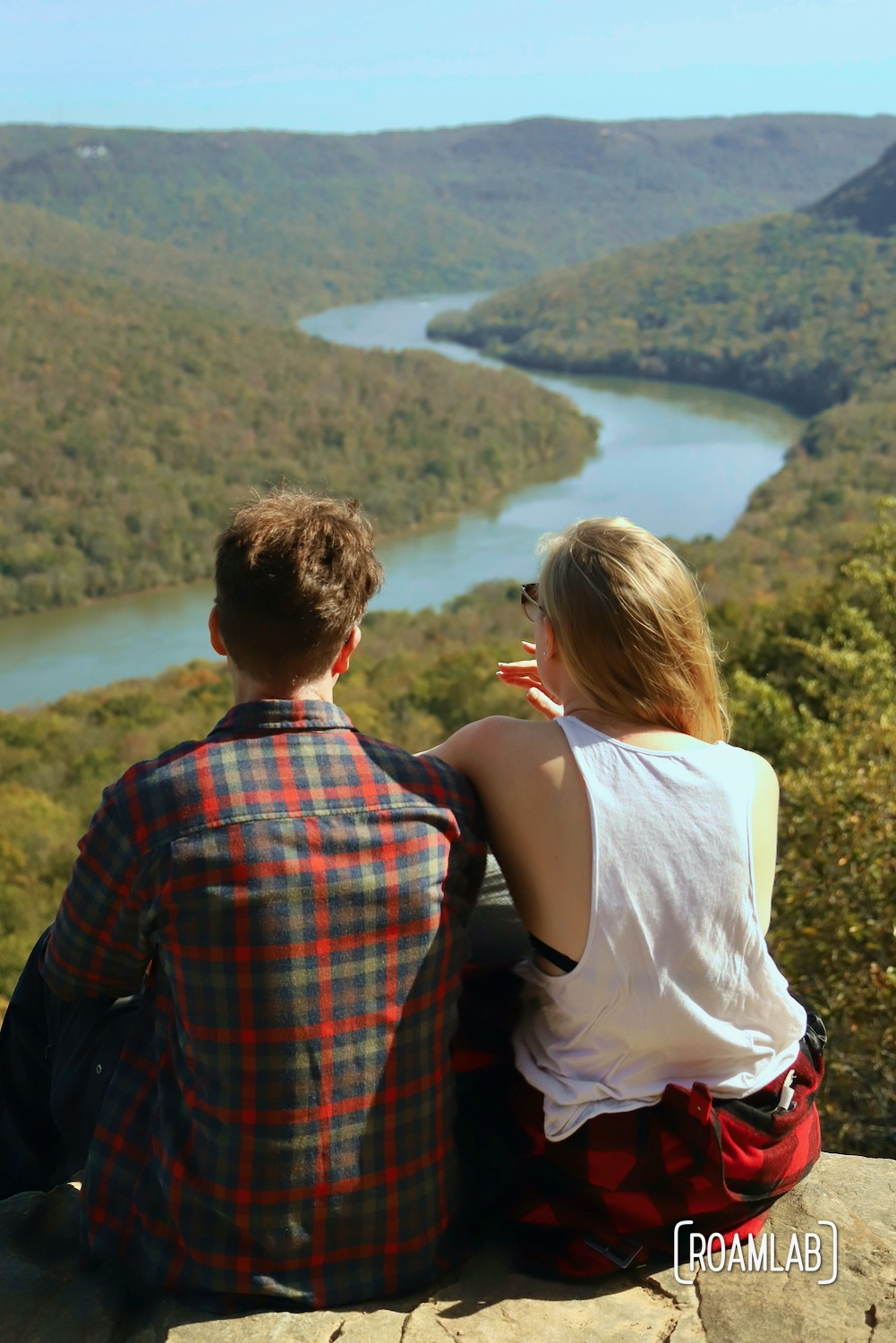 Man and woman looking out over the Tennessee River Gorge of Prentice Cooper State Park from Snoopers Rock.