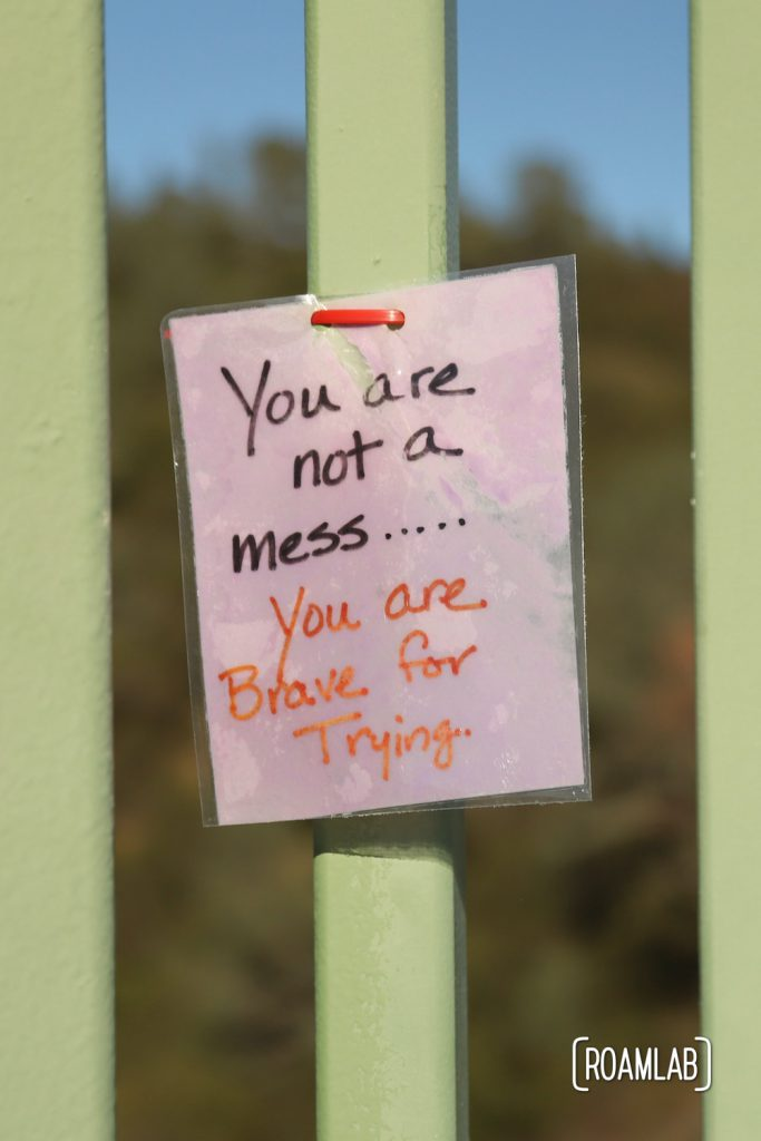 """Laminated message tied to Foresthill Bridge: """"You are not a mess...You are Brave for Trying"""""""