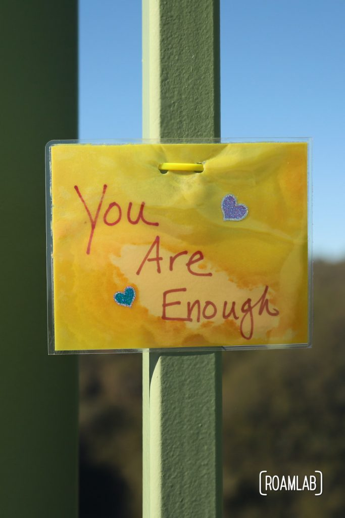 """Laminated message tied to Foresthill Bridge: """"You Are Enough"""""""