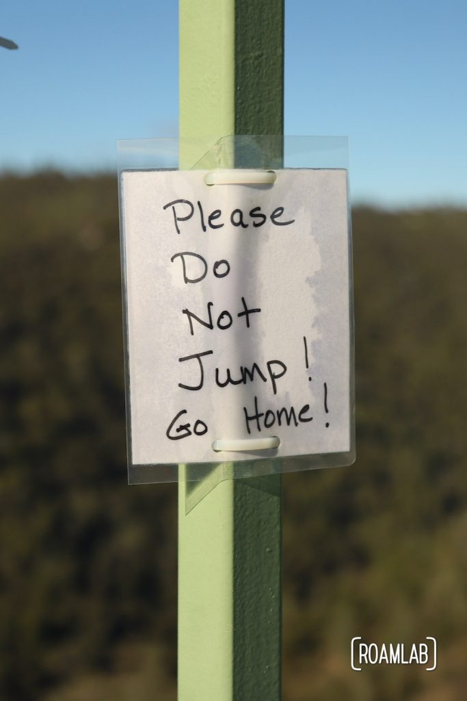 """Laminated message tied to Foresthill Bridge: """"Please Do Not Jump! Go Home!"""""""