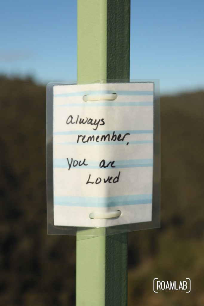 """Laminated message tied to Foresthill Bridge: """"Always remember, You are Loved"""""""