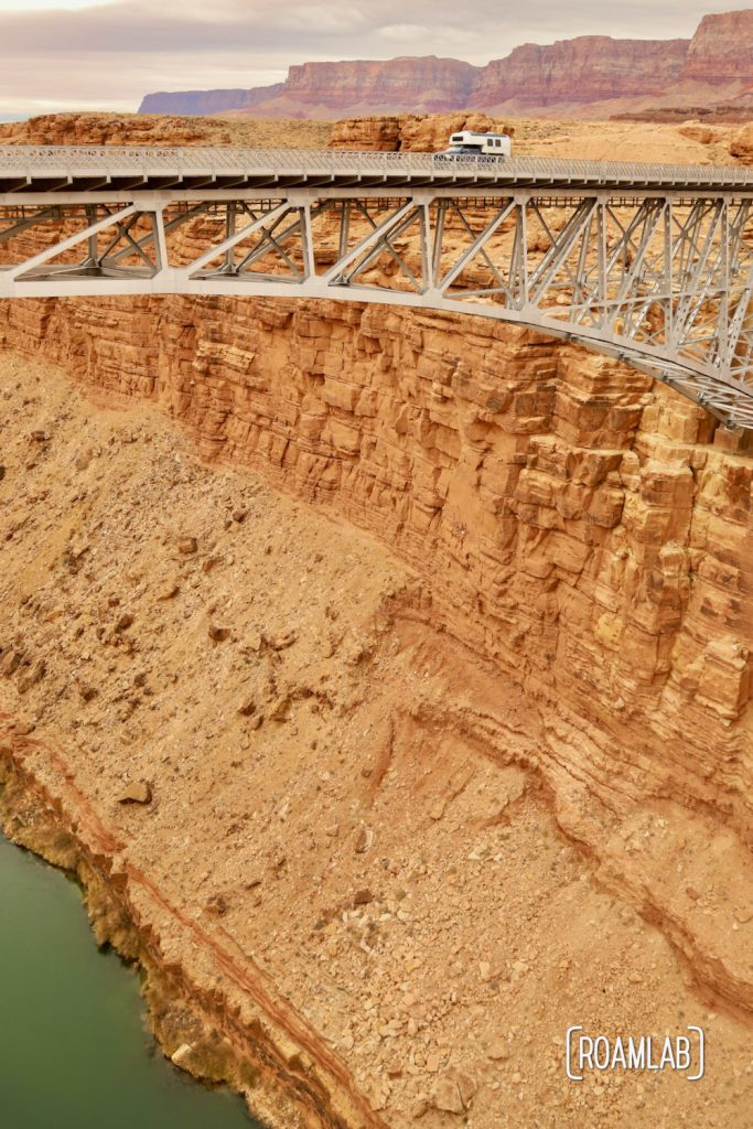 1970 Avion C11 truck campe crossing the Colorado River at Marble Canyon on the Navajo Bridge.