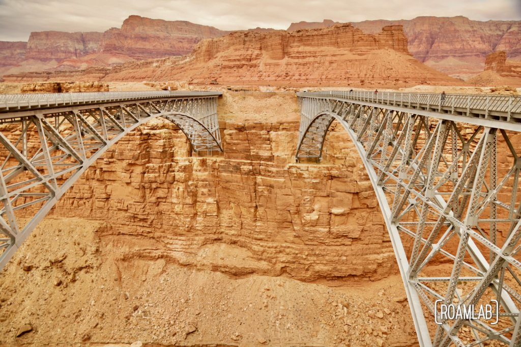 Two bridges crossing the gold cliffs of Marble Canyon and the Colorado River.
