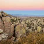 Sunrise over a valley of hoodoos along Echo Canyon Loop Trail at Chiricahua National Monument Arizona
