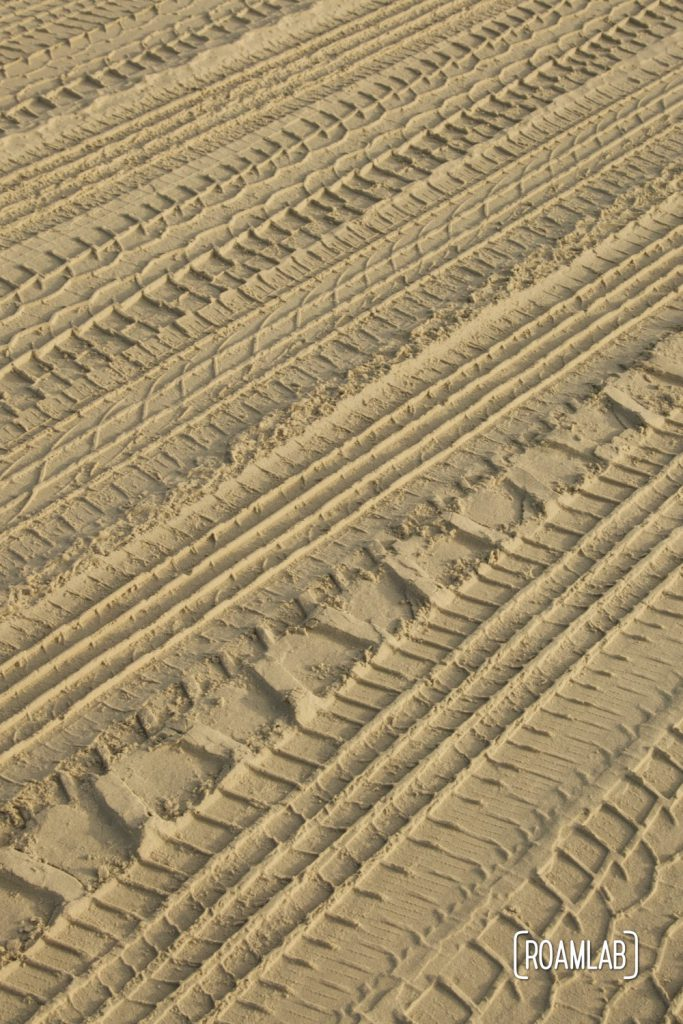 Closeup of tire tracks in the sand at South Beach Padre Island National Seashore, Texas.