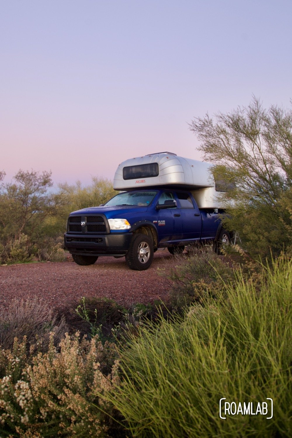 1970 Avion C11 truck camper parked among desert shrubbery at Cholla Campground.