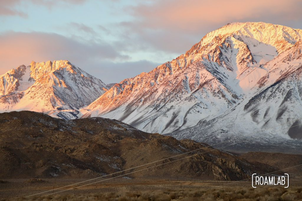 Sunrise view of the snow capped Sierra Nevada from Pleasant Valley Pit near Bishop, California.
