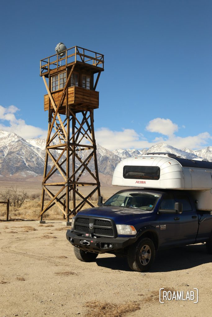 Manzanar watch tower reconstruction with a 1970 Avion C11 truck camper with the Sierra Nevada in the background.