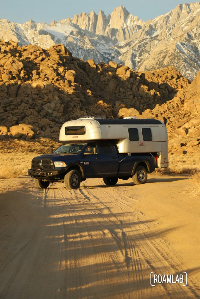 1970 Avion C11 Truck Camper on a blue Ram truck in the Alabama Hills with Mount Whitney in the background among the Sierra Nevada.