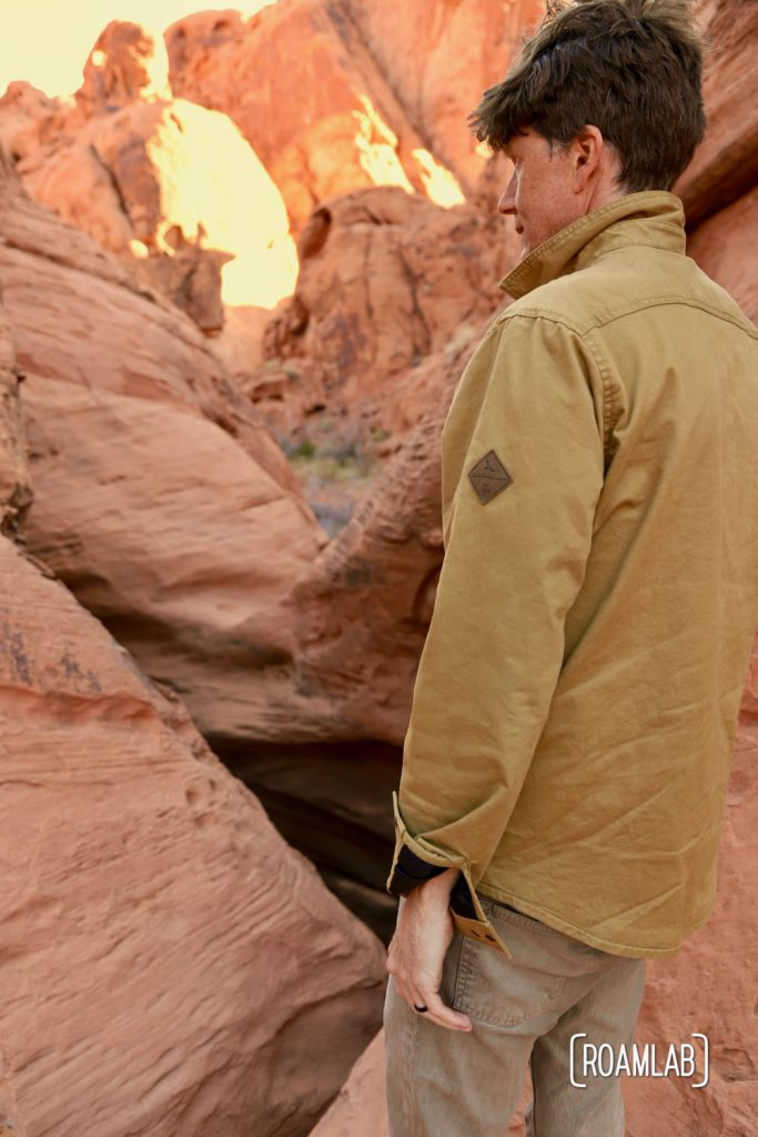 Man looking into the natural reservoir of Mouse Tank, Valley of Fire State Park.
