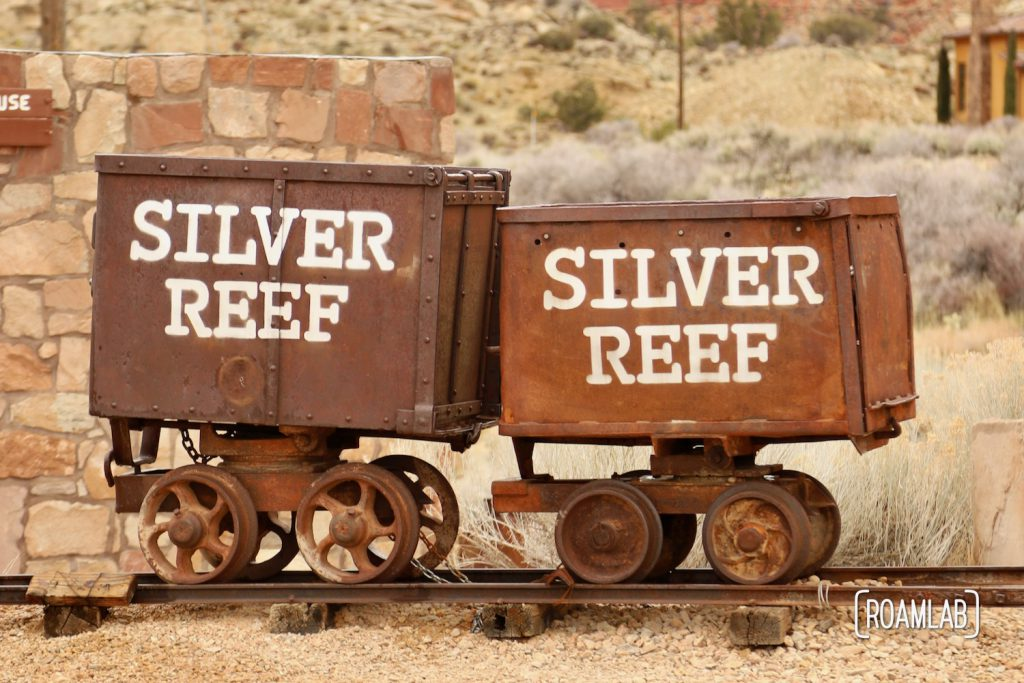 """Mining carts with """"Silver Reef"""" painted on the side."""