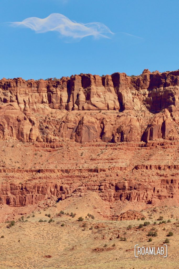 Sunsoaked Vermillion Cliffs with a brilliant blue skie.