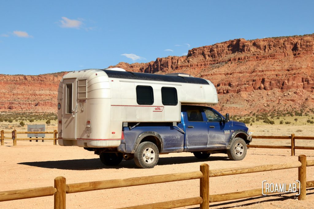 Dusty 1970 Avion C11 truck camper parked at the Condor Viewing Site with the Vermillion Cliffs in the background.