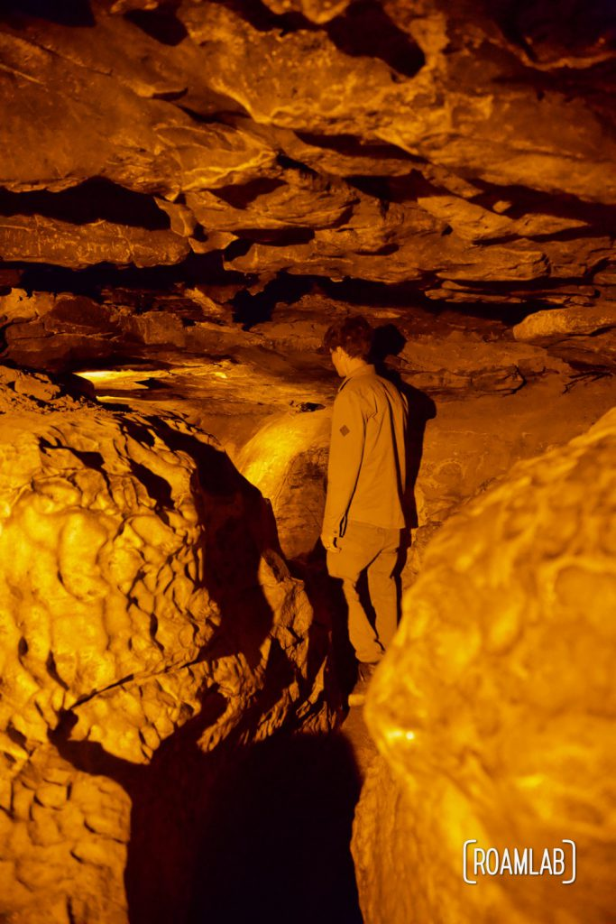 Man spelunking through Fat Man's Misery on the Geology Tour of Mammoth Cave National Park.