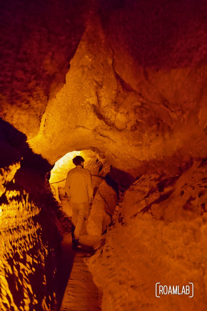 Man spelunking through the narrow passages on the Geology Tour of Mammoth Cave National Park.