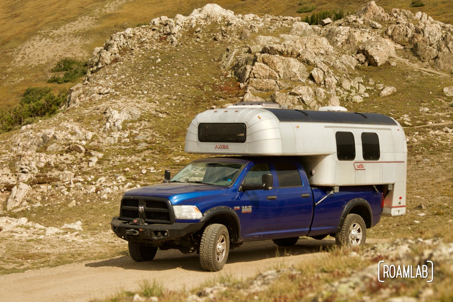 1970 Avion C11 truck camper on a 2015 Ram 2500 tradesman truck camper driving through the alpine tundra on Old River Road in Rocky Mountain National Park.